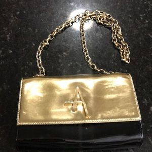 Black and gold patent  leather clutch